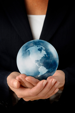 Businesswoman holding globe in hands