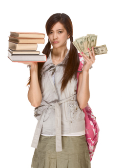 Female student holding money in one hand and stack of books in the other