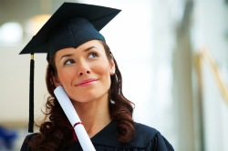 Young woman holding a diploma