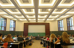 Students in lecture hall, view from behind