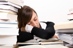 College student sleeping while while studying