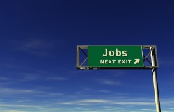 Freeway sign that reads jobs next exit