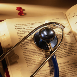 Stethoscope on top of a medical dictionary
