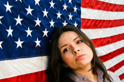 Latin woman standing in front of American flag