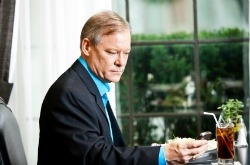 Businessman checking email during dinner