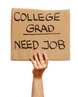 College grad holding 'Need Job' sign