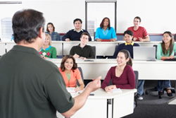 Professor talking in front of students in a classroom