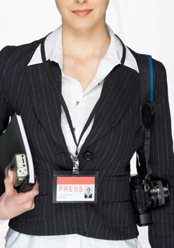 Female journalist hold notebook, recorder, camera and press pass