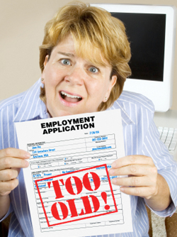Shocked woman holding employment application marked too old