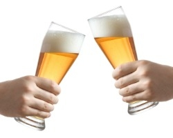 Two people holding beer glasses