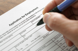 Person filling out employment application