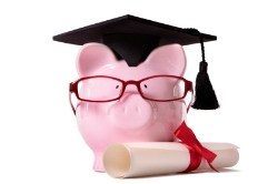 Piggy bank with graduation cap and diploma