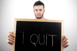 Frustrated employee with I Quit sign