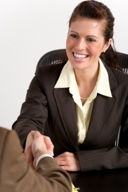 woman shaking hands during promotion