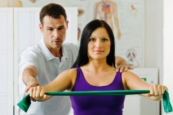 physical therapists conducting session with woman