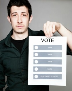 Young adult holding voting ballot