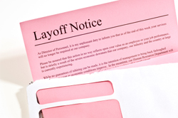 Close up of pink layoff notice