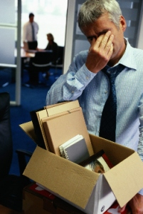 Distressed man packing up office supplies