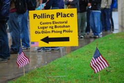 Polling Place sign, college students in background