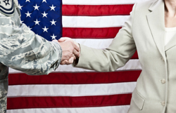Close up of handshake between military member and female civilian