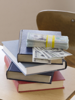 Stack of Money on top of a Stack of Books