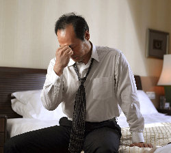 Frustrated businessman in hotel room