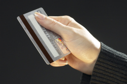woman holding a debit card