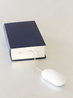 Hardcover book connected to computer mouse