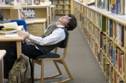 Student Asleep in School Library
