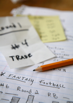 Close up of fantasy football team notes and pencil