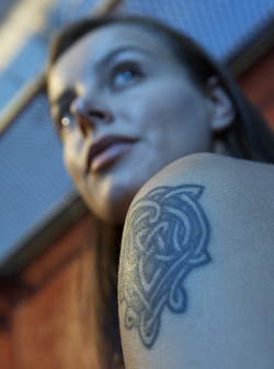 Woman with tattoo on shoulder