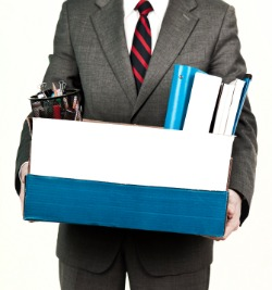 unemployed man holding box of belongings