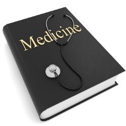 Medical textbook and stethoscope