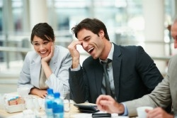 Employees laughing during meeting