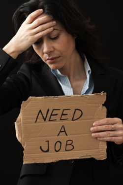 Worried business woman holding need a job sign
