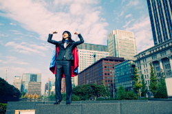 Businesswoman wearing cape