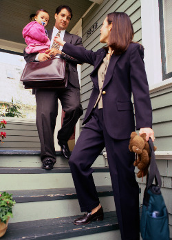 Working parents leaving house with child