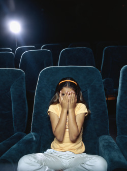 Girl scared in movie theater
