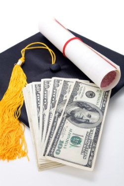 Graduation cap with diploma and money